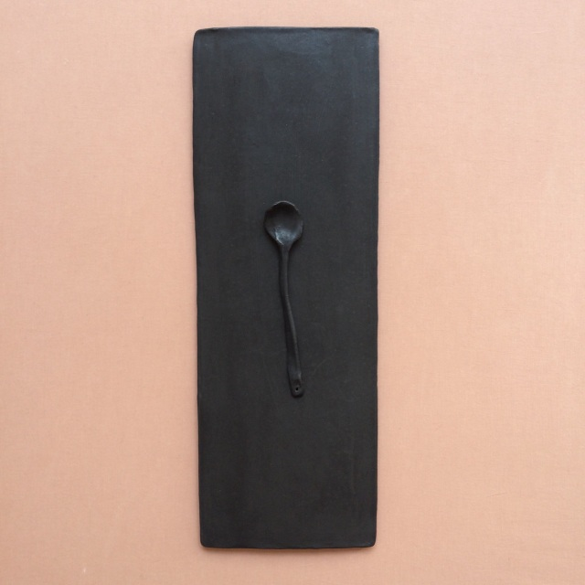 single tile and spoon